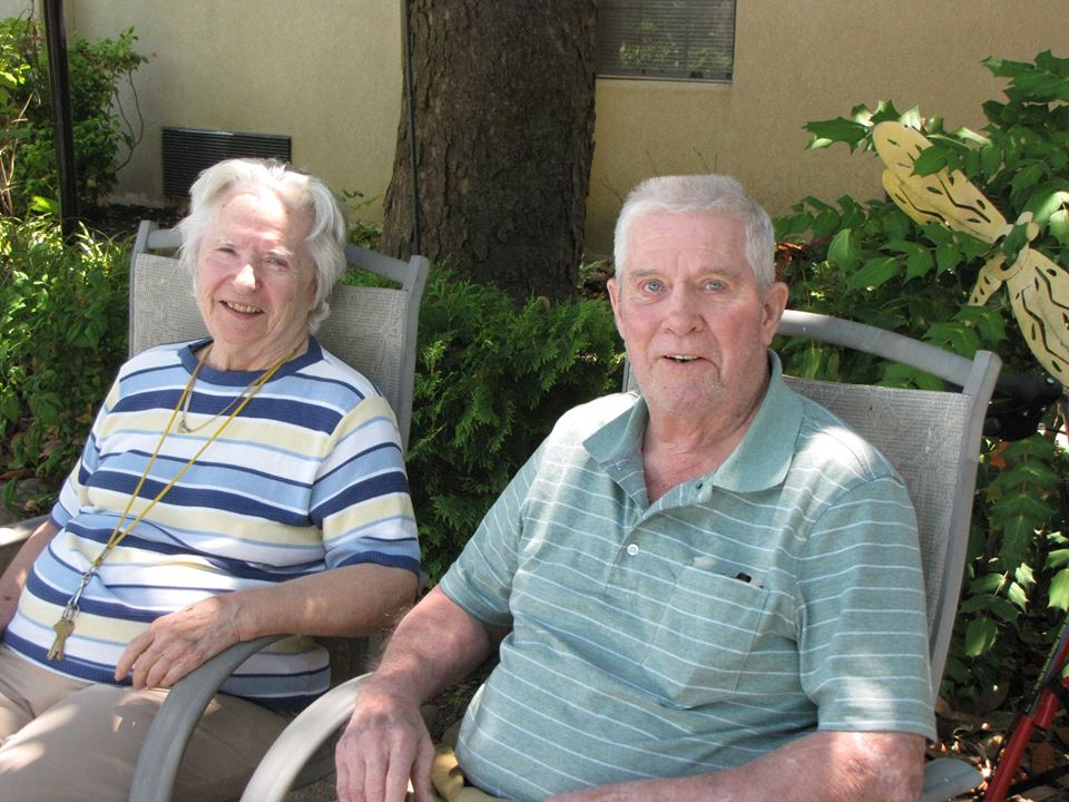 East Ridge Residence   Resident couple sitting outdoors