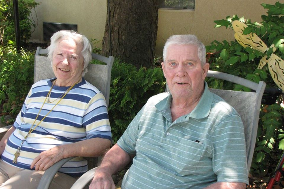 East Ridge Residence | Resident couple sitting outdoors